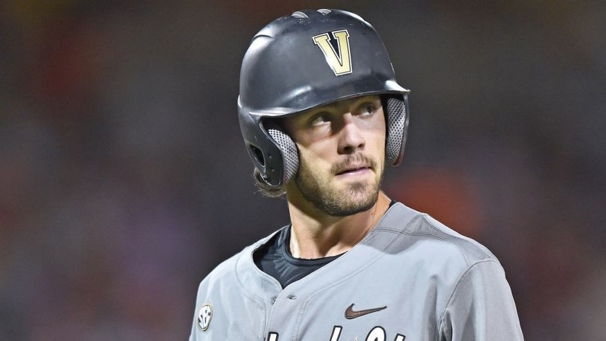 Omaha, NE - JUNE 23: Dansby Swanson #7 of the Vanderbilt Commodores reacts after lining out against the Virginia Cavaliers in the eighth inning during game two of the College World Series Championship Series on June 23, 2015 at TD Ameritrade Park in Omaha, Nebraska. (Photo by Peter Aiken/Getty Images)