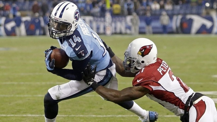 <p>Tennessee Titans wide receiver Michael Preston scores a touchdown on an 8-yard pass play as he is defended by Arizona Cardinals cornerback Patrick Peterson with 37 seconds left in the fourth quarter of an NFL football game Sunday, Dec. 15, 2013, in Nashville, Tenn. The extra point tied the game to send it into overtime. (AP Photo/Wade Payne)</p>