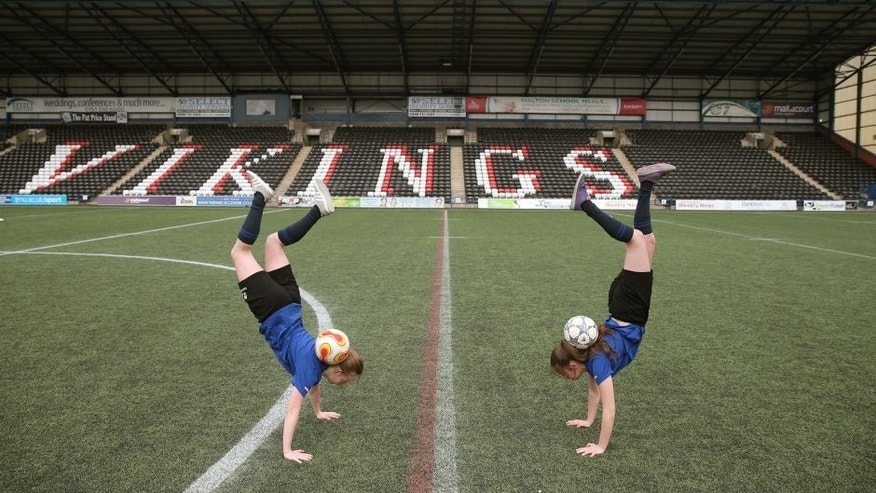 WIDNES, ENGLAND - APRIL 05: Football freestylers in action ahead of the FA WSL 2 match between Everton Ladies and London Bees at the Select Security Stadium on April 5, 2015 in Widnes, England. (Photo by Chris Brunskill - The FA/The FA via Getty Images)