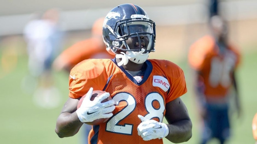 Aug 20, 2014; Englewood, CO, USA; Denver Broncos running back Montee Ball (28) runs drills before the start of a scrimmage against the Houston Texans at the Broncos training facility. Mandatory Credit: Ron Chenoy-USA TODAY Sports
