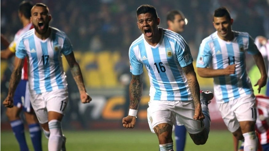 CONCEPCION, CHILE - JUNE 30: Marcos Rojo (C) of Argentina celebrates after scoring the opening goal during the 2015 Copa America Chile Semi Final match between Argentina and Paraguay at Ester Roa Rebolledo Stadium on June 30, 2015 in Concepcion, Chile. (Photo by Raul Sifuentes/LatinContent/Getty Images)