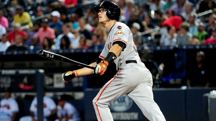 ATLANTA, GA - AUGUST 5: Kelby Tomlinson #37 of the San Francisco Giants knocks in a run with a fourth inning single against the Atlanta Braves at Turner Field on August 5, 2015 in Atlanta, Georgia. (Photo by Scott Cunningham/Getty Images)