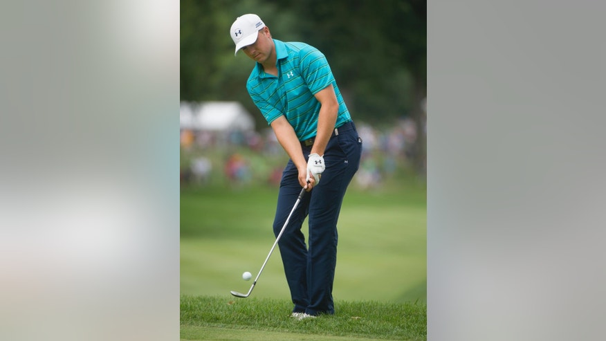 Jordan Spieth hits a chip to the second green during the first round of the Bridgestone Invitational golf tournament, in Akron, Ohio, Thursday, Aug. 6, 2015. (AP Photo/Phil Long)