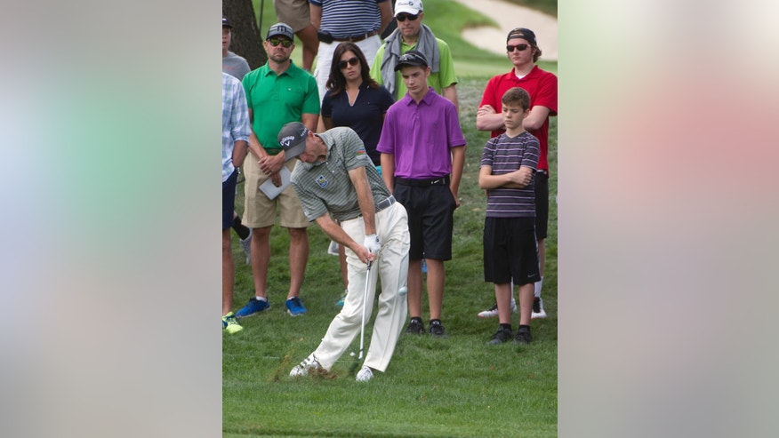 Jim Furyk hit his second shot from the fairway rough, on the third hole, during the first round of the Bridgestone Invitational golf tournament, in Akron, Ohio, Thursday, Aug. 6, 2015. (AP Photo/Phil Long)