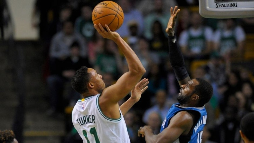 <p>Dec 19, 2014; Boston, MA, USA; Boston Celtics guard Evan Turner (11) shoots the ball over Minnesota Timberwolves forward Shabazz Muhammad (15) during the first half at TD Garden. Mandatory Credit: Bob DeChiara-USA TODAY Sports</p>