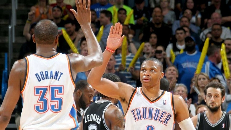 OKLAHOMA CITY, OK - APRIL 03: Kevin Durant #35 and Russell Westbrook #0 of the Oklahoma City Thunder celebrate during a game against the San Antonio Spurs on April 03, 2014 at the Chesapeake Energy Arena in Oklahoma City, Oklahoma. NOTE TO USER: User expressly acknowledges and agrees that, by downloading and or using this Photograph, user is consenting to the terms and conditions of the Getty Images License Agreement. Mandatory Copyright Notice: Copyright 2014 NBAE (Photo by Layne Murdoch Jr./NBAE via Getty Images)