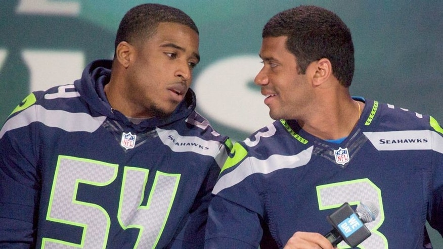 SEATTLE, WA - MARCH 21: (L-R) Super Bowl Champion Seattle Seahawks NFL players Bobby Wagner and Russell Wilson speak on on stage during We Day at Key Arena on March 21, 2014 in Seattle, Washington. (Photo by Mat Hayward/Getty Images)