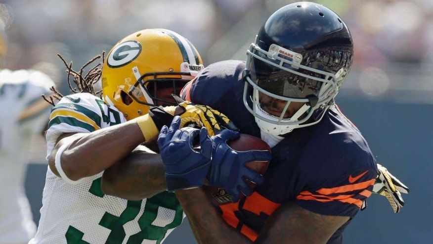 Green Bay Packers cornerback Tramon Williams (left) tackles Chicago Bears tight end Martellus Bennett in the first half.