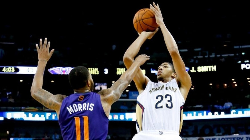 Nov 5, 2013; New Orleans, LA, USA; New Orleans Pelicans power forward Anthony Davis (23) shoots over Phoenix Suns power forward Markieff Morris (11) during the second quarter at New Orleans Arena. Mandatory Credit: Derick E. Hingle-USA TODAY Sports