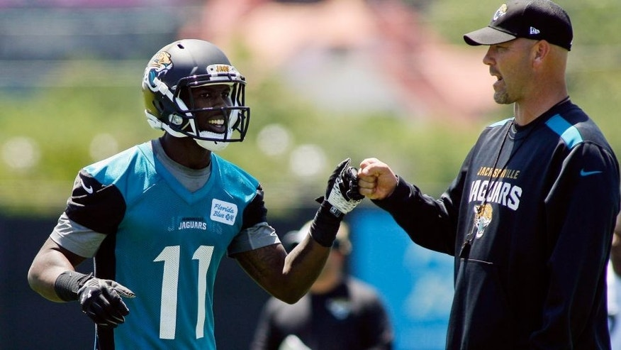 May 16, 2014; Jacksonville, FL, USA; Jacksonville Jaguars wide receiver Marqise Lee (11) bumps fists with head coach Gus Bradley during rookie minicamp at Florida Blue Health and Wellness Practice Fields. Mandatory Credit: Phil Sears-USA TODAY Sports