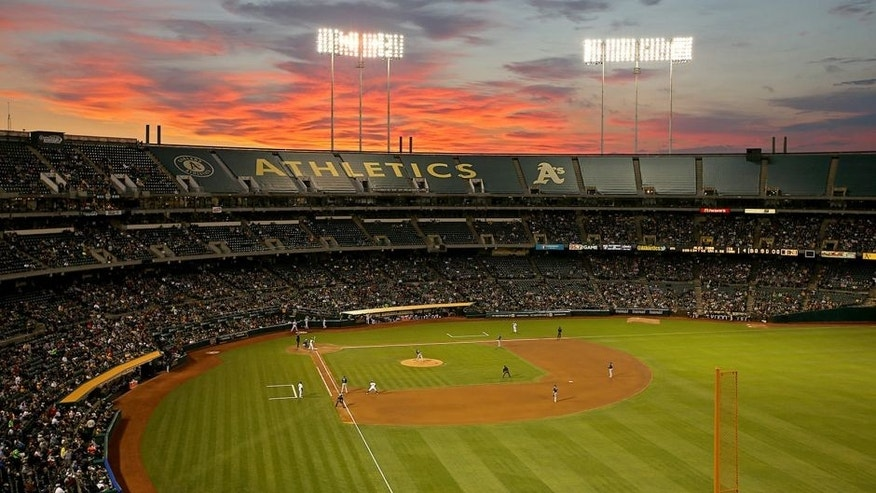 <p>OAKLAND, CA - AUGUST 4: Wide angle interior scenic view at sunset during the game between the Tampa Bay Rays and Oakland Athletics at O.co Coliseum on Monday, August 4, 2014 in Oakland, California. (Photo by Brad Mangin/MLB Photos via Getty Images) *** Local Caption ***</p>