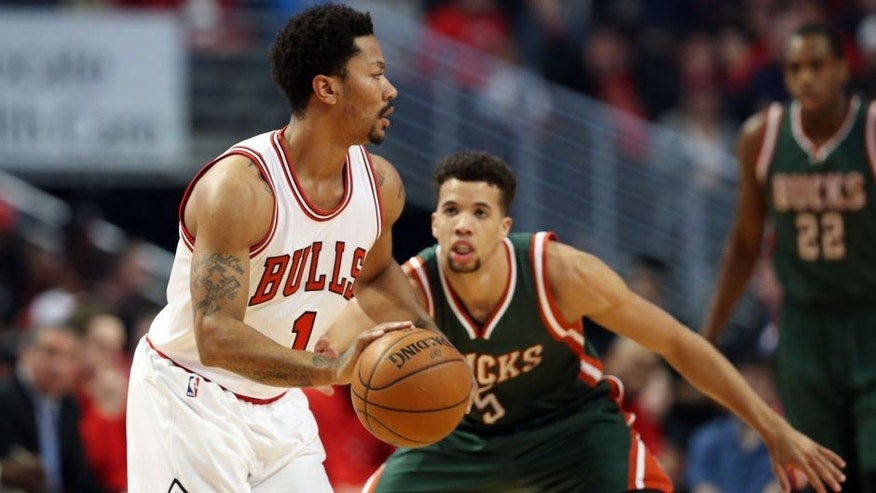 <p>Apr 18, 2015; Chicago, IL, USA; Chicago Bulls guard Derrick Rose (1) controls the ball against Milwaukee Bucks guard Michael Carter-Williams (5) during the first quarter in game one of the first round of the 2015 NBA Playoffs at United Center. Mandatory Credit: Jerry Lai-USA TODAY Sports</p>
