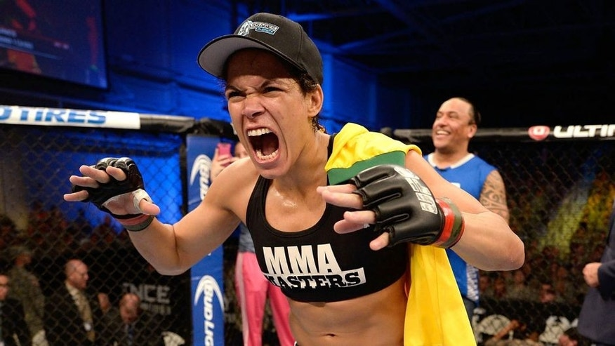 FORT CAMPBELL, KENTUCKY - NOVEMBER 6: Amanda Nunes reacts to her victory over Germaine de Randamie in their UFC women's bantamweight bout on November 6, 2013 in Fort Campbell, Kentucky. (Photo by Jeff Bottari/Zuffa LLC/Zuffa LLC via Getty Images)