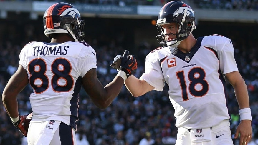 <p>Dec 29, 2013; Oakland, CA, USA; Denver Broncos wide receiver Demaryius Thomas (88) celebrates with quarterback Peyton Manning (18) after scoring a touchdown against the Oakland Raiders during the second quarter at O.co Coliseum. Mandatory Credit: Kelley L Cox-USA TODAY Sports</p>