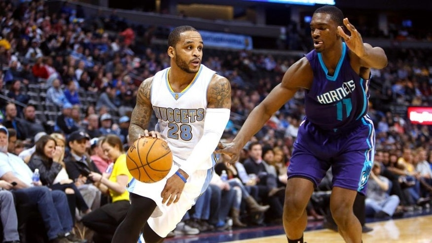 Jan 31, 2015; Denver, CO, USA; Denver Nuggets guard Jameer Nelson (28) drives to the basket against Charlotte Hornets forward Noah Vonleh (11) during the second half at Pepsi Center. The Hornets won 104-86. Mandatory Credit: Chris Humphreys-USA TODAY Sports