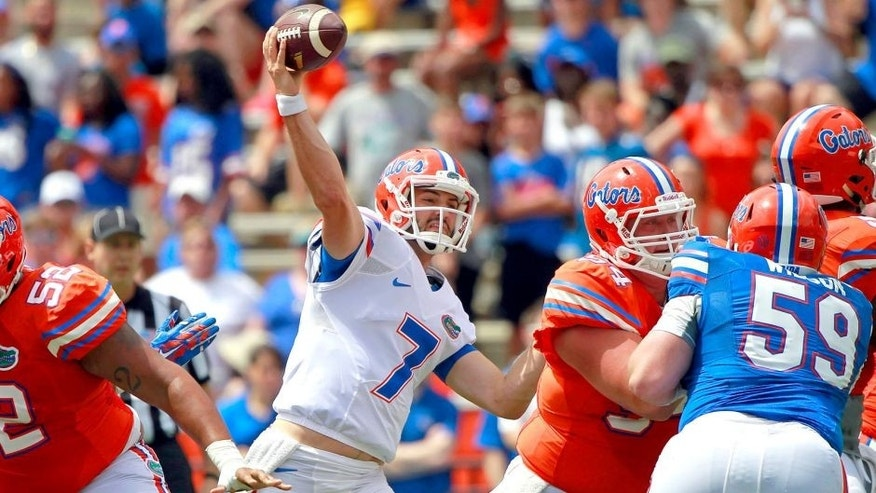 Apr 11, 2015; Gainesville, FL, USA; Florida Gators quarterback Will Grier (7) throws the ball during the first half at the Orange and Blue Debut at Ben Hill Griffin Stadium. Mandatory Credit: Kim Klement-USA TODAY Sports