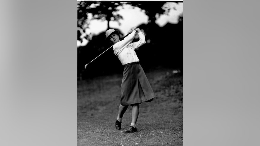 FILE - In this June 25, 1946 file photo, Louise Suggs of Lithia Springs, Ga., drives from the 10th during the second day of the Women's Western Open Golf Tournament at Des Moines, Iowa. The LPGA Tour says Suggs, an LPGA founder and one of the greatest female golfers of all time, died Friday, Aug. 7, 2015, in Sarasota, Fla. She was 91. The LPGA did not list a cause of death.  (AP Photo/Em, File)