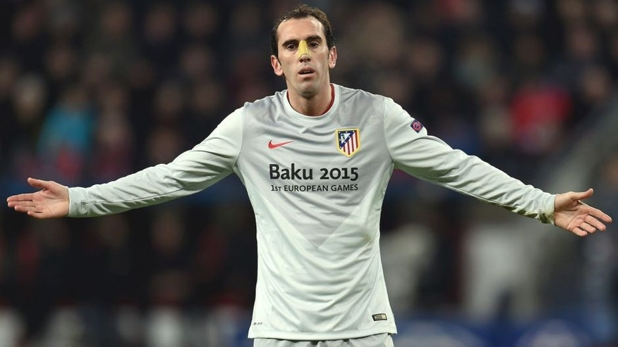 Atletico Madrid's Uruguayan defender Diego Godin reacts during the UEFA Champions League first-leg, round of 16 football match Bayer 04 Leverkusen vs Club Atletico de Madrid in Leverkusen, western Germany on February 25, 2015. AFP PHOTO / PATRIK STOLLARZ (Photo credit should read PATRIK STOLLARZ/AFP/Getty Images)