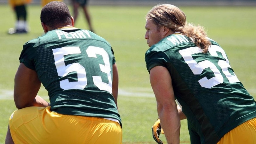 <p>May 22, 2012; Green Bay, WI, USA; Green Bay Packers linebacker Clay Matthews (52) talks to fellow linebacker Nick Perry (53) during the Green Bay Packers organized team activities at Ray Nitschke Field. Mandatory Credit: Mary Langenfeld-USA TODAY Sports ,May 22, 2012; Green Bay, WI, USA; Green Bay Packers linebacker Clay Matthews (52) talks to fellow linebacker Nick Perry (53) during the Green Bay Packers organized team activities at Ray Nitschke Field. Mandatory Credit: Mary Langenfeld-USA TODAY Sports</p>