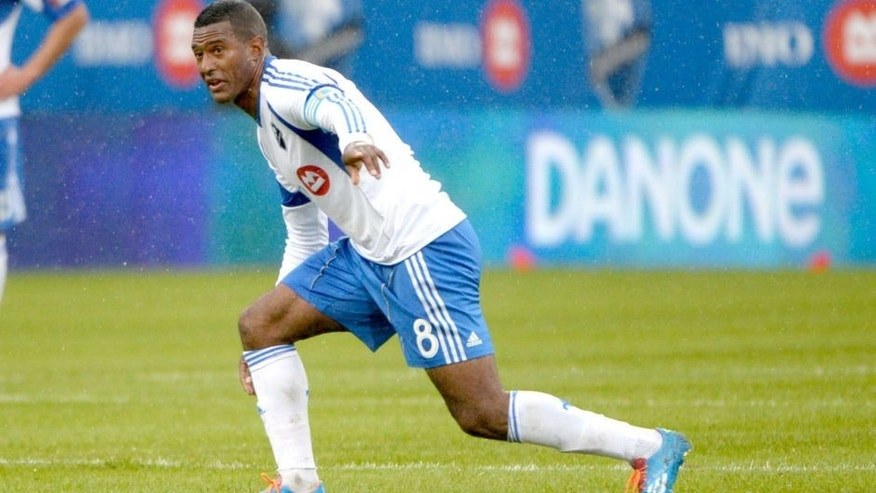 Apr 26, 2014; Montreal, Quebec, Canada; Montreal Impact midfielder Patrice Bernier (8) directs teammates during the first half against the Philadelphia Union at Stade Saputo. Mandatory Credit: Eric Bolte-USA TODAY Sports