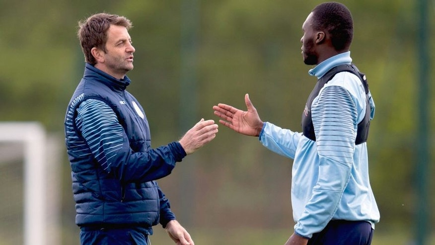 BIRMINGHAM, ENGLAND - MAY 07 : Tim Sherwood, manager of Aston Villa greets Christian Benteke during a Aston Villa training session at the club's training ground at Bodymoor Heath on May 07, 2015 in Birmingham, England. (Photo by Neville Williams/Aston Villa FC via Getty Images)