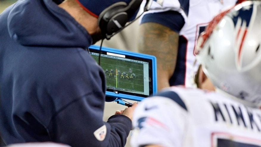 GREEN BAY, WI - NOVEMBER 30: A New England Patriots coach uses the Microsoft Surface tablet to go over plays during the fourth quarter against the Green Bay Packers at Lambeau Field on November 30, 2014 in Green Bay, Wisconsin. The Packers defeated the Patriots 26-21. (Photo by Brian D. Kersey/Getty Images)