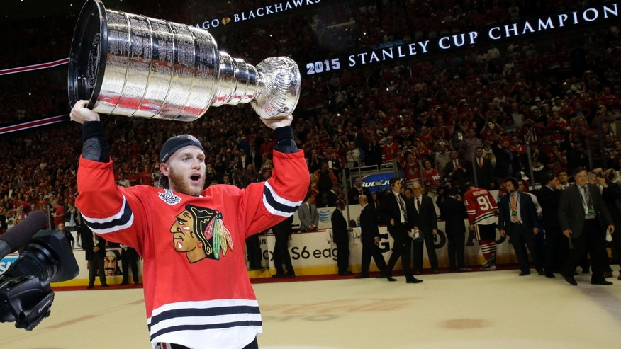 June 15, 2015: Chicago Blackhawks right wing Patrick Kane celebrates after defeating the Tampa Bay Lightning in Game 6 of the NHL hockey Stanley Cup Final series in Chicago.
