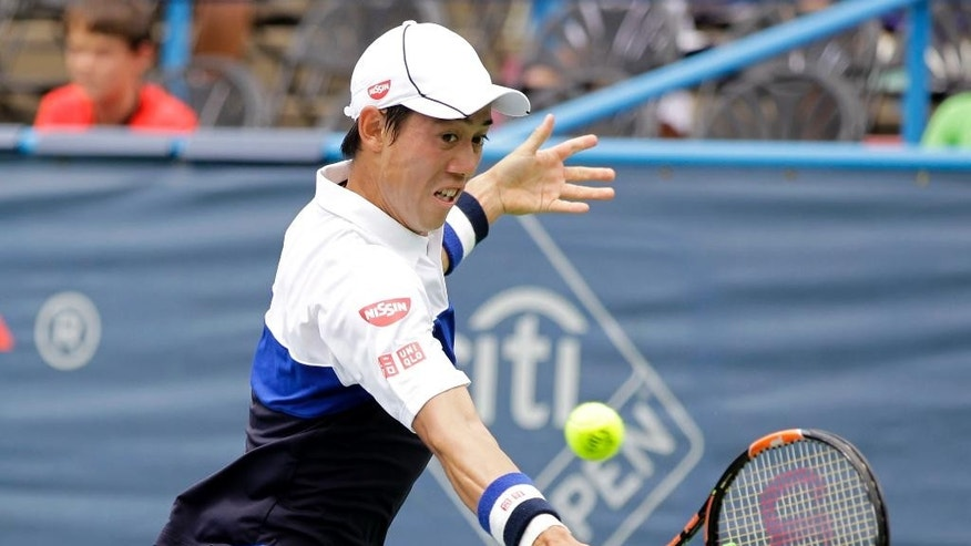 Kei Nishikori, of Japan, reaches for a return against Sam Groth, of Australia, during a quarterfinal match at the Citi Open tennis tournament, Friday, Aug. 7, 2015, in Washington. (AP Photo/Luis M. Alvarez)