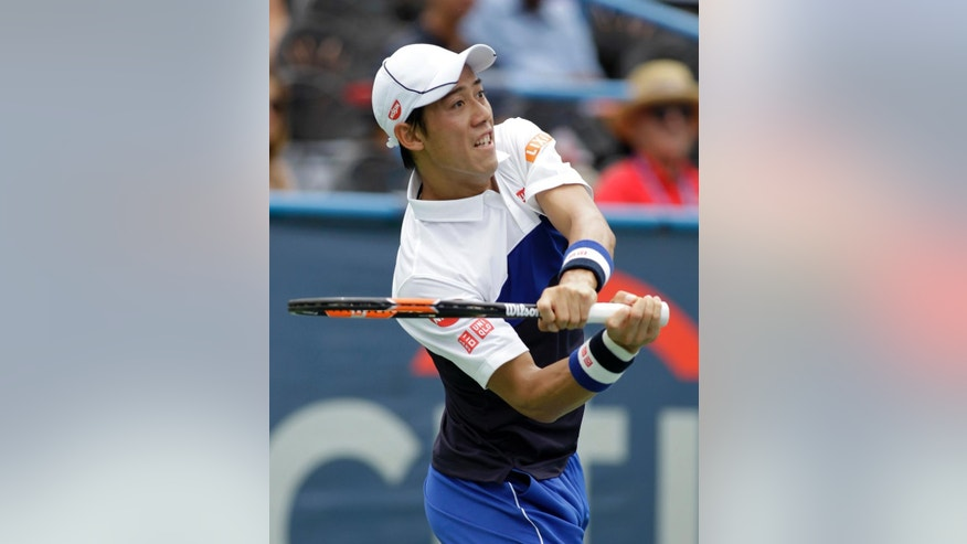 Kei Nishikori, of Japan, follows through on a return to Sam Groth, of Australia, during their quarterfinal match at the Citi Open tennis tournament, Friday, Aug. 7, 2015, in Washington. (AP Photo/Luis M. Alvarez)