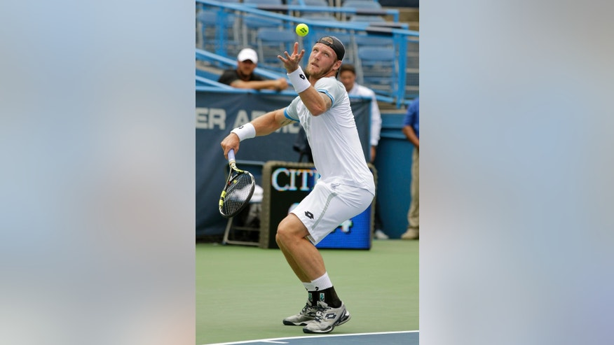 Sam Groth, of Australia, serves the ball to Kei Nishikori, of Japan, during their quarterfinal match at the Citi Open tennis tournament, Friday Aug. 7, 2015, in Washington. (AP Photo/Luis M. Alvarez)