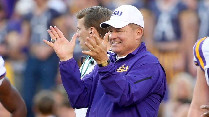 Oct 25, 2014; Baton Rouge, LA, USA; LSU Tigers head coach Les Miles claps for his team during pre game warm ups on the field prior to kickoff against the Mississippi Rebels at Tiger Stadium. LSU defeated Mississippi 10-7. Mandatory Credit: Crystal LoGiudice-USA TODAY Sports