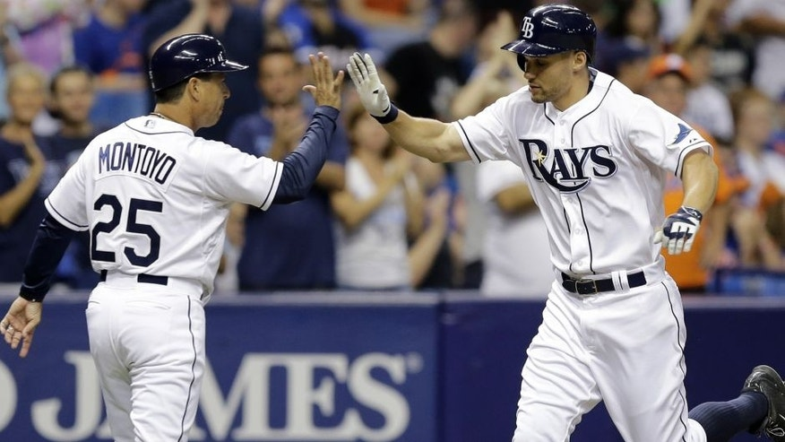 Tampa Bay Rays' Grady Sizemore, right, high-fives third base coach Charlie Montoyo (25) after hitting a home run off New York Mets starting pitcher Jacob deGrom during the fourth inning of an interleague baseball game Friday, Aug. 7, 2015, in St. Petersburg, Fla. (AP Photo/Chris O'Meara)