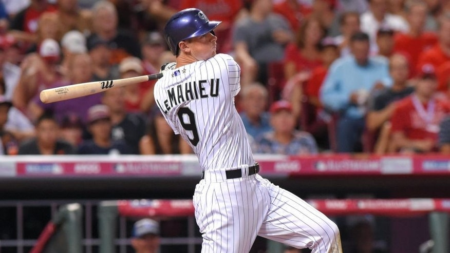 CINCINNATI, OH - JULY 14: National League All-Star DJ LeMahieu #9 of the Colorado Rockies bats during the 86th MLB All-Star Game at Great American Ball Park on July 14, 2015 in Cincinnati, Ohio. The American League defeated the National League 6-3. (Photo by Mark Cunningham/MLB Photos via Getty Images)