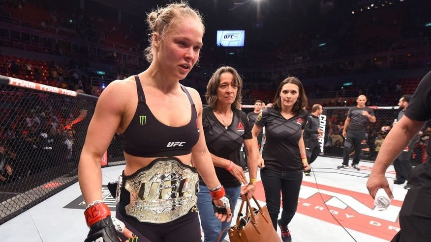RIO DE JANEIRO, BRAZIL - AUGUST 01: Ronda Rousey of the United States celebrates her knock out victory over Bethe Correia of Brazil in the first round in their UFC women's bantamweight championship bout during the UFC 190 event inside HSBC Arena on August 1, 2015 in Rio de Janeiro, Brazil. (Photo by Josh Hedges/Zuffa LLC/Zuffa LLC via Getty Images)
