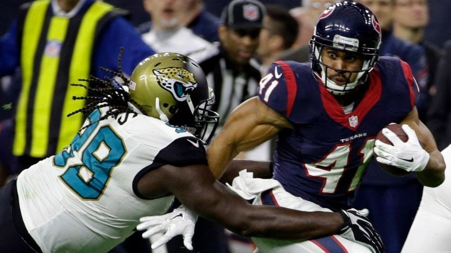 <p>Houston Texans running back Jonathan Grimes (41) tries to get by Jacksonville Jaguars defensive tackle Sen'Derrick Marks (99) during the first half of an NFL football game Sunday, Dec. 28, 2014, in Houston. (AP Photo/David J. Phillip)</p>