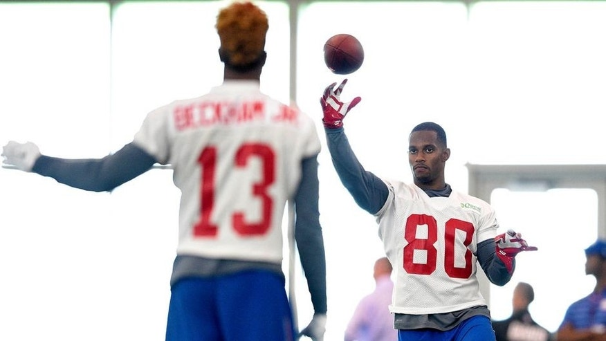 Jun 16, 2015; East Rutherford, NJ, USA; New York Giants wide receiver Odell Beckham Jr, (13) throws to wide receiver Victor Cruz (80) during minicamp at Quest Diagnostics Training Center. Mandatory Credit: Steven Ryan-USA TODAY Sports