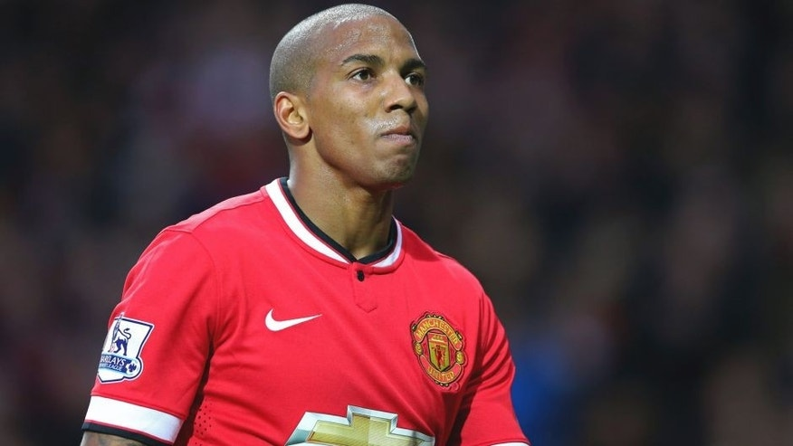 MANCHESTER, ENGLAND - MARCH 15: Ashley Young of Manchester United looks on during the Barclays Premier League match between Manchester United and Tottenham Hotspur at Old Trafford on March 15, 2015 in Manchester, England. (Photo by Alex Livesey/Getty Images)