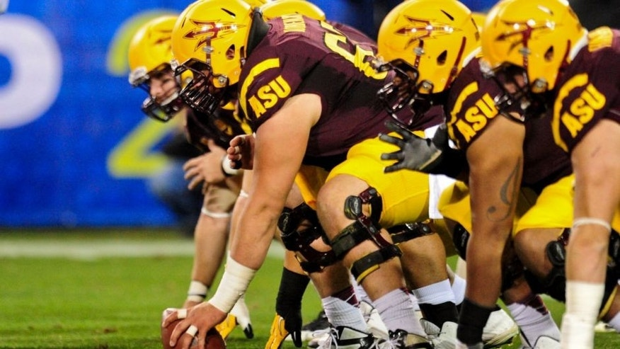 Dec 7, 2013; Tempe, AZ, USA; The Arizona State Sun Devils offensive line squares off against the Stanford Cardinal defense during the first half at Sun Devil Stadium. Mandatory Credit: Matt Kartozian-USA TODAY Sports