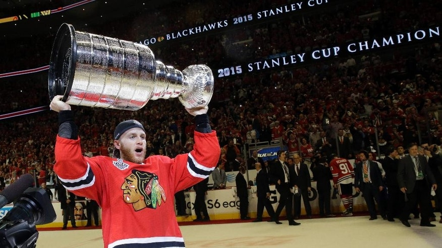 "FILE - In this June 15, 2015, file photo, Chicago Blackhawks right wing Patrick Kane celebrates after defeating the Tampa Bay Lightning in Game 6 of the NHL hockey Stanley Cup Final series  in Chicago. The NHL says it is ""following developments"" of a police investigation involving Chicago Blackhawks star Patrick Kane, Thursday, Aug. 6, 2015. (AP Photo/Nam Y. Huh, File)"