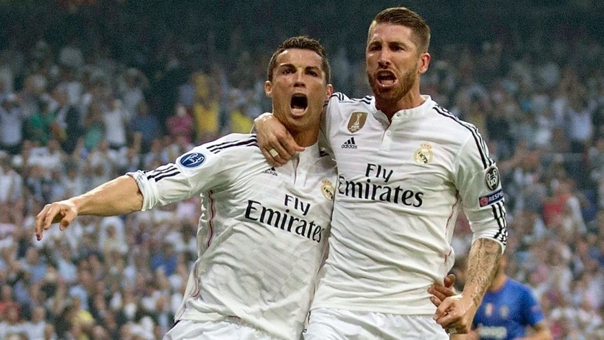 MADRID, SPAIN - MAY 13: (L-R) Cristiano Ronaldo of Real Madrid celebrates with teammate Sergio Ramos of Real Madrid after scoring the opening goal from the penalty spot during the UEFA Champions League Semi Final, second leg match between Real Madrid and Juventus at Estadio Santiago Bernabeu on May 13, 2015 in Madrid, Spain. (Photo by Gonzalo Arroyo Moreno/Getty Images)