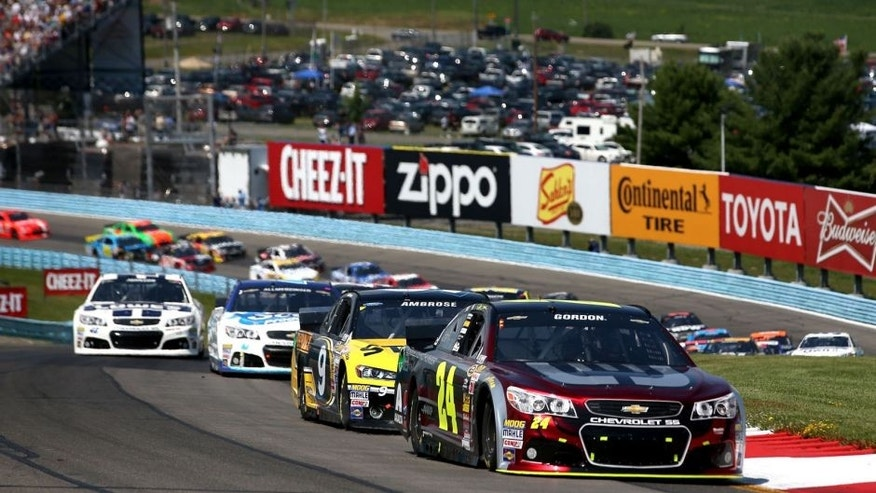 WATKINS GLEN, NY - AUGUST 10: Jeff Gordon, driver of the #24 Drive to End Hunger Chevrolet, leads a pack of cars during the NASCAR Sprint Cup Series Cheez-It 355 at Watkins Glen International on August 10, 2014 in Watkins Glen, New York. (Photo by Chris Graythen/NASCAR via Getty Images)