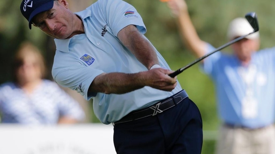 Jim Furyk tees off on the 12th hole during the second round of the Bridgestone Invitational golf tournament at Firestone Country Club, Friday, Aug. 7, 2015, in Akron, Ohio. (AP Photo/Tony Dejak)