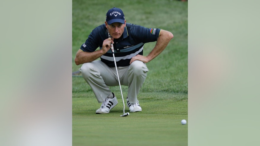 Jim Furyk lines up the putt on the 3rd hole during the third round of the Bridgestone Invitational golf tournament at Firestone Country Club, Saturday, Aug. 8, 2015, in Akron, Ohio. (AP Photo/Tony Dejak)