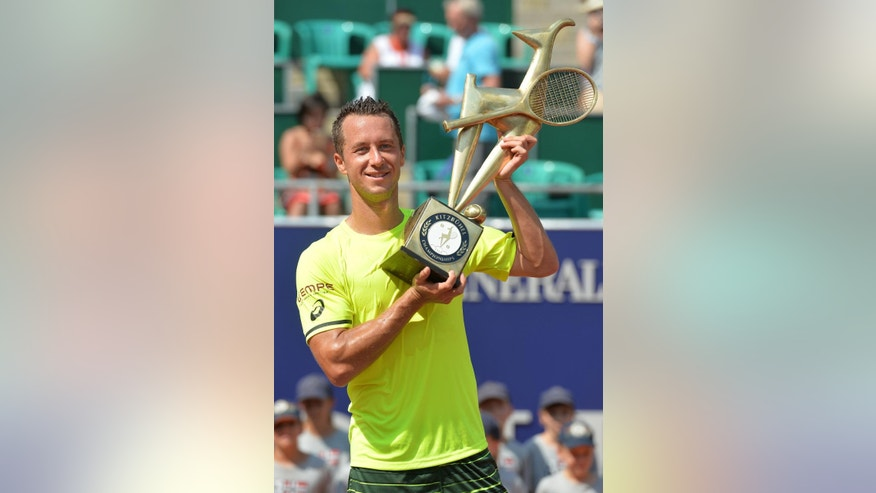 Germany's Philipp Kohlschreiber poses with the trophy after winning the final match against France's Paul-Henri Mathieu at the Generali Open tennis tournament in Kitzbuehel, Austria, Saturday, Aug. 8, 2015.  Kohlschreiber won with 2-6, 6-2 and 6-2. (AP Photo/Kerstin Joensson)