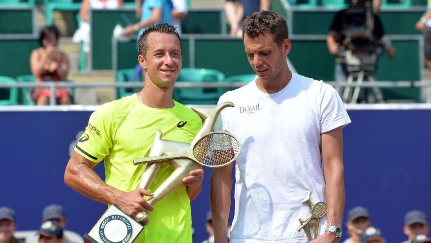 Germany's winner Philipp Kohlschreiber, left, and France's Paul-Henri Mathieu pose for media after their final match at the Generali Open tennis tournament in Kitzbuehel, Austria, Saturday, Aug. 8, 2015.  Kohlschreiber won with 2-6, 6-2 and 6-2. (AP Photo/Kerstin Joensson)