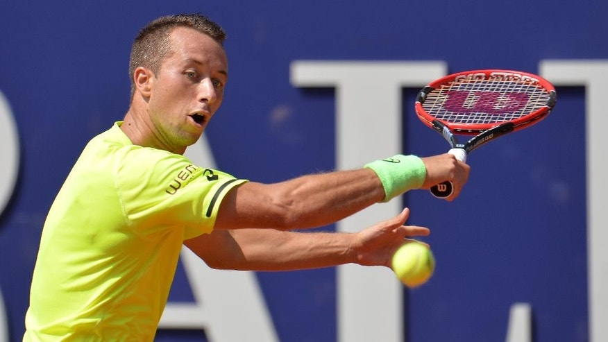 Germany's Philipp Kohlschreiber returns the ball to France's Paul-Henri Mathieu during their final match at the Generali Open tennis tournament in Kitzbuehel, Austria, Saturday, Aug. 8, 2015. Kohlschreiber won with 2-6, 6-2 and 6-2. (AP Photo/Kerstin Joensson)