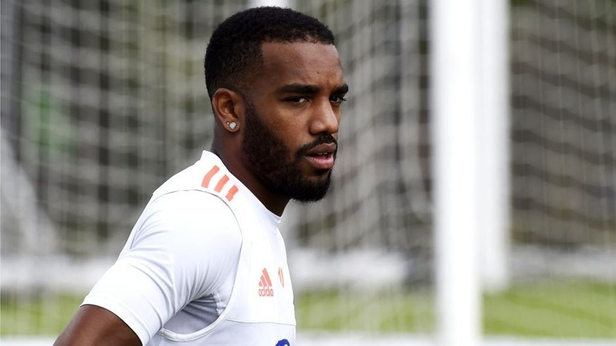 Lyon's Frecnh forward Alexandre Lacazette attends a training session ahead of the 2015/2016 French L1 football season on July 28, 2015 in Lyon. AFP PHOTO/PHILIPPE DESMAZES (Photo credit should read PHILIPPE DESMAZES/AFP/Getty Images)