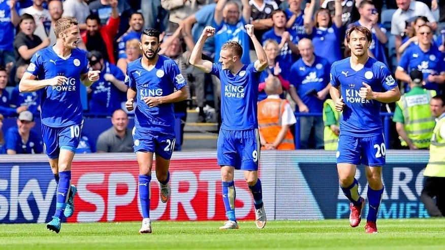 Leicester City's English striker Jamie Vardy (2nd R) celebrates after scoring the opening goal during the English Premier League football match between Leicester City and Sunderland at King Power Stadium in Leicester, central England on August 8, 2015. AFP PHOTO / BEN STANSALL RESTRICTED TO EDITORIAL USE. No use with unauthorized audio, video, data, fixture lists, club/league logos or 'live' services. Online in-match use limited to 75 images, no video emulation. No use in betting, games or single club/league/player publications. (Photo credit should read BEN STANSALL/AFP/Getty Images)