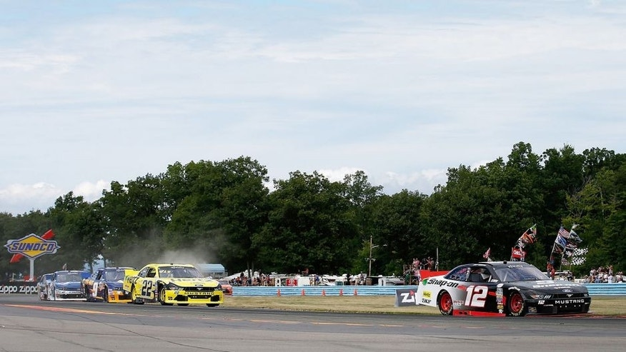 WATKINS GLEN, NY - AUGUST 08: Joey Logano, driver of the #12 Snap-on Ford, leads Brad Keselowski, driver of the #22 Hertz Ford, and others during the NASCAR XFINITY Series Zippo 200 at Watkins Glen International on August 8, 2015 in Watkins Glen, New York. (Photo by Todd Warshaw/Getty Images)