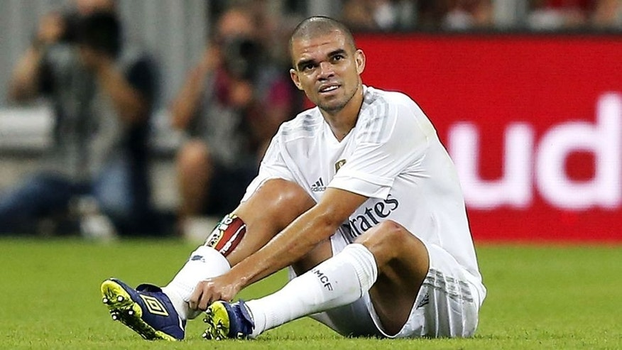 MUNICH, GERMANY - AUGUST 05: Pepe of Real Madrid sits injured on the pitch during the Audi Cup 2015 match between FC Bayern Munich and Real Madrid at Allianz Arena on August 5, 2015 in Munich, Germany. (Photo by Angel Martinez/Real Madrid via Getty Images)